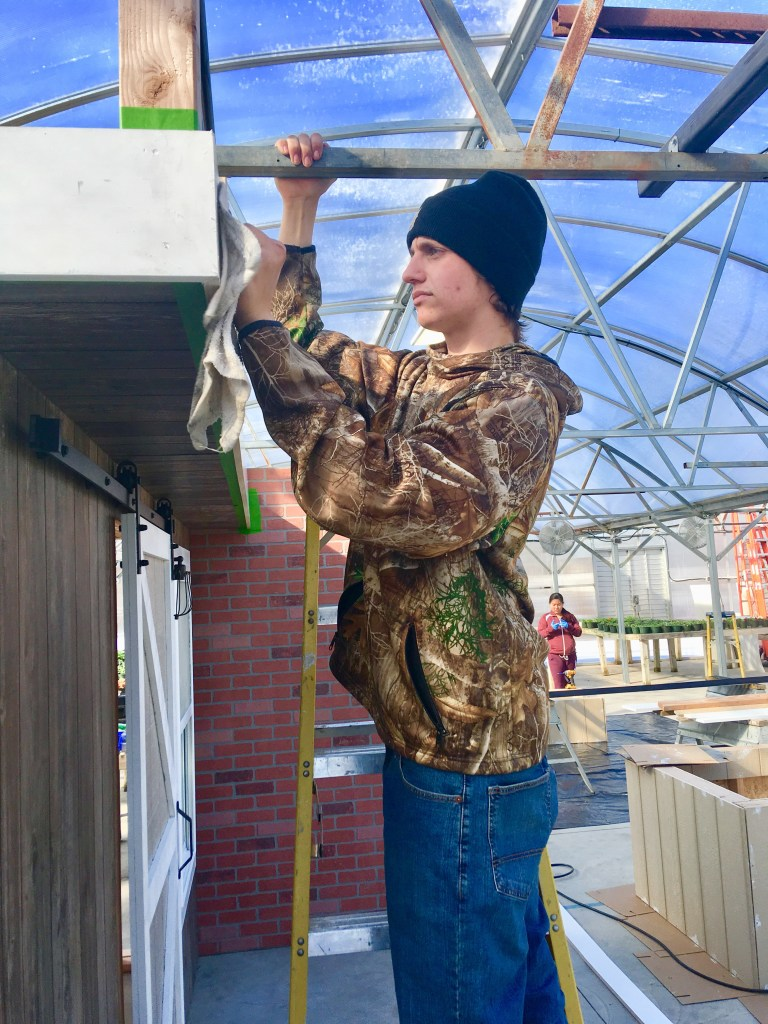 student erecting display