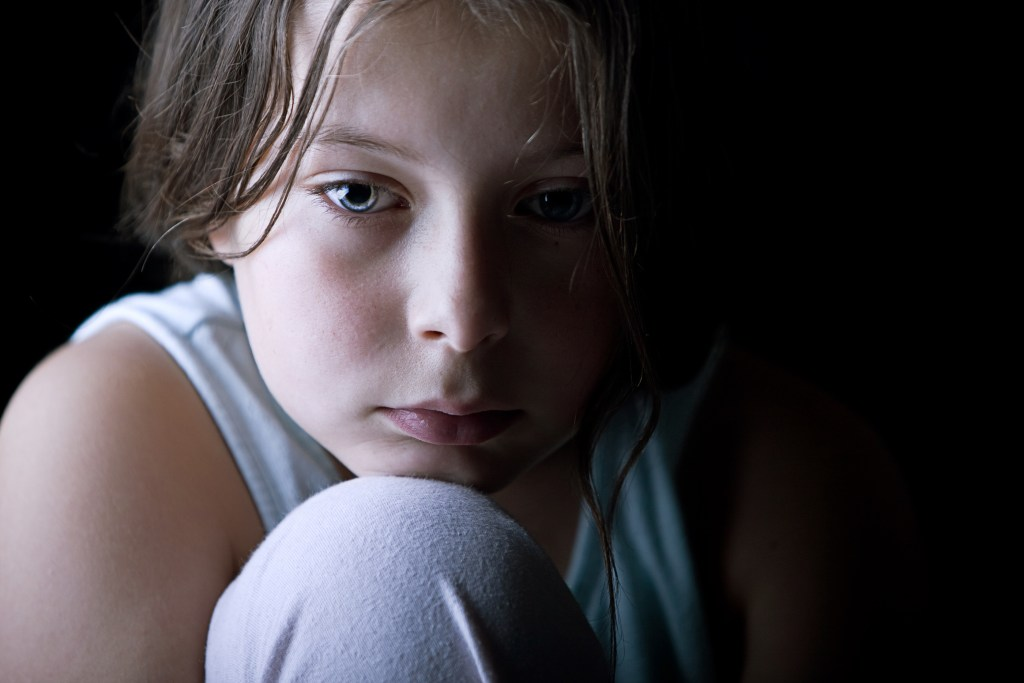 image of a Young Child Looking Sad