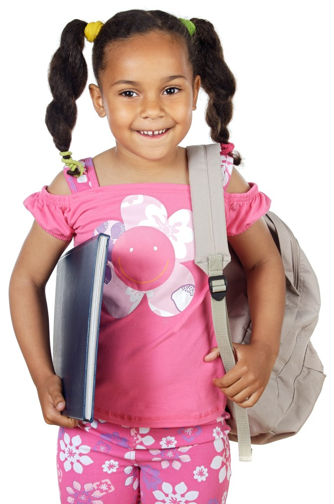 Little girl with notebook and bookbag.