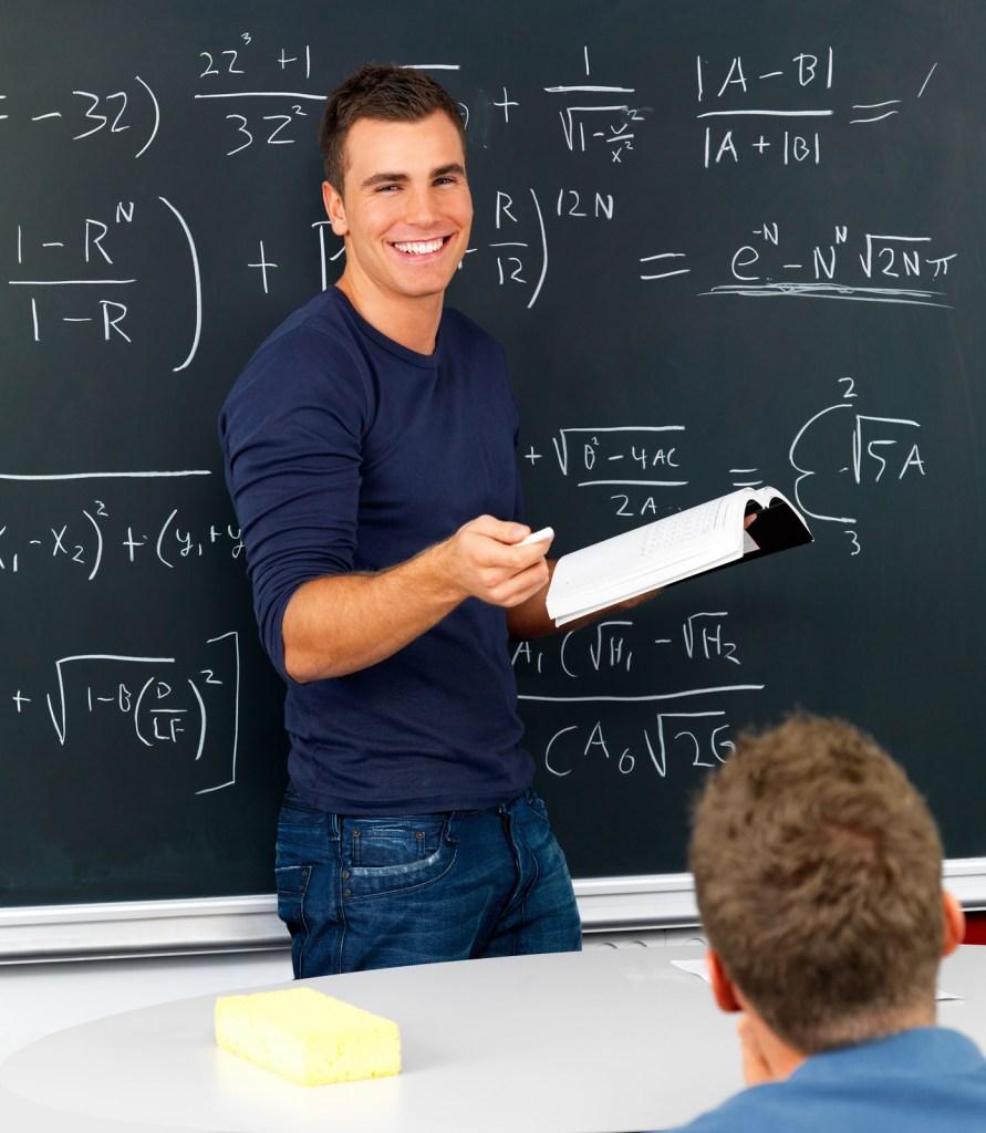 Teacher at chalkboard.