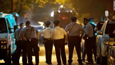 police officers in Philly after 6 shot by gunman