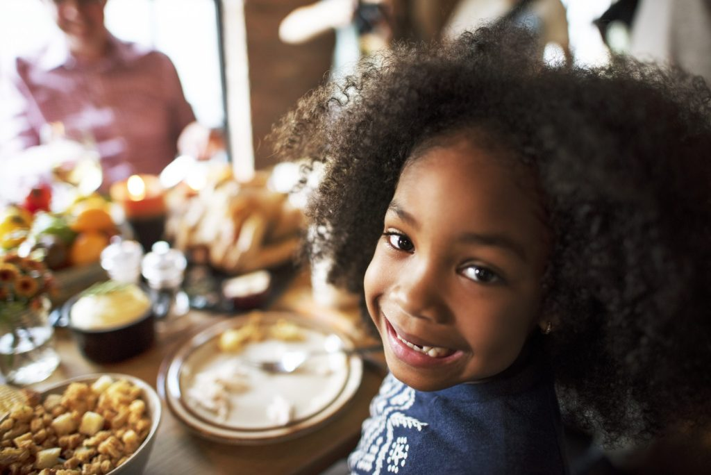 Little Kid Smiling Thanksgiving Celebration Concept