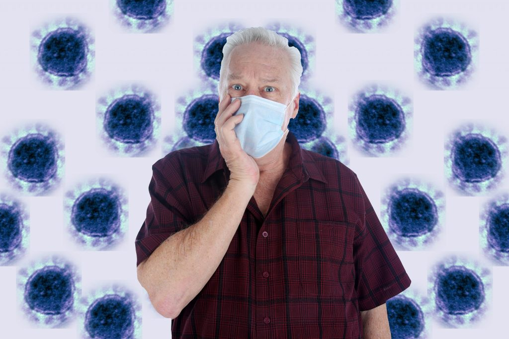 A man wearing a paper mask is scared of contracting the CORONAVIRUS.