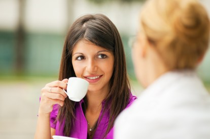 two business women drinking coffee espresso outdoors
