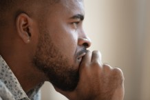 Close up of pensive biracial man thinking having problems