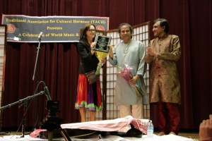 UCLA faculty Abhiman Kaushal receiving Award of Excellence from Beth Macmillan with Chakrapani Singh