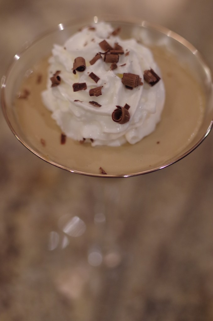 Espresso panna cotta with whip cream and chocolate shavings