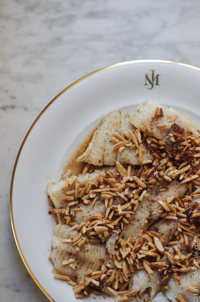This brown butter almond trout recipe is buttery deep, warm, and nutty. It's easy, quick to make, and makes you weak in the knees. Make sure you've got fresh bread near by to mop up your plate. | www.lakesidetable.com