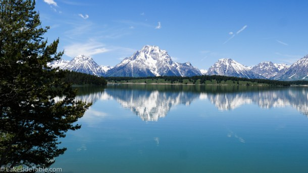Clear water reflecting snow capped mountains. Glorious! | www.lakesidetable.com