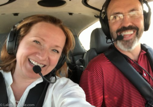 two people in cockpit of cirrus sr22