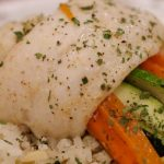 Put a different twist on your next fish dish... literally!  Light buttery fish wrapped gently around brightly colored veggies nestled over a bed of wild rice will make any weeknight seem like a special date night dinner. | www.lakesidetable.com