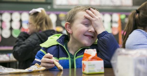 young boy having school breakfast