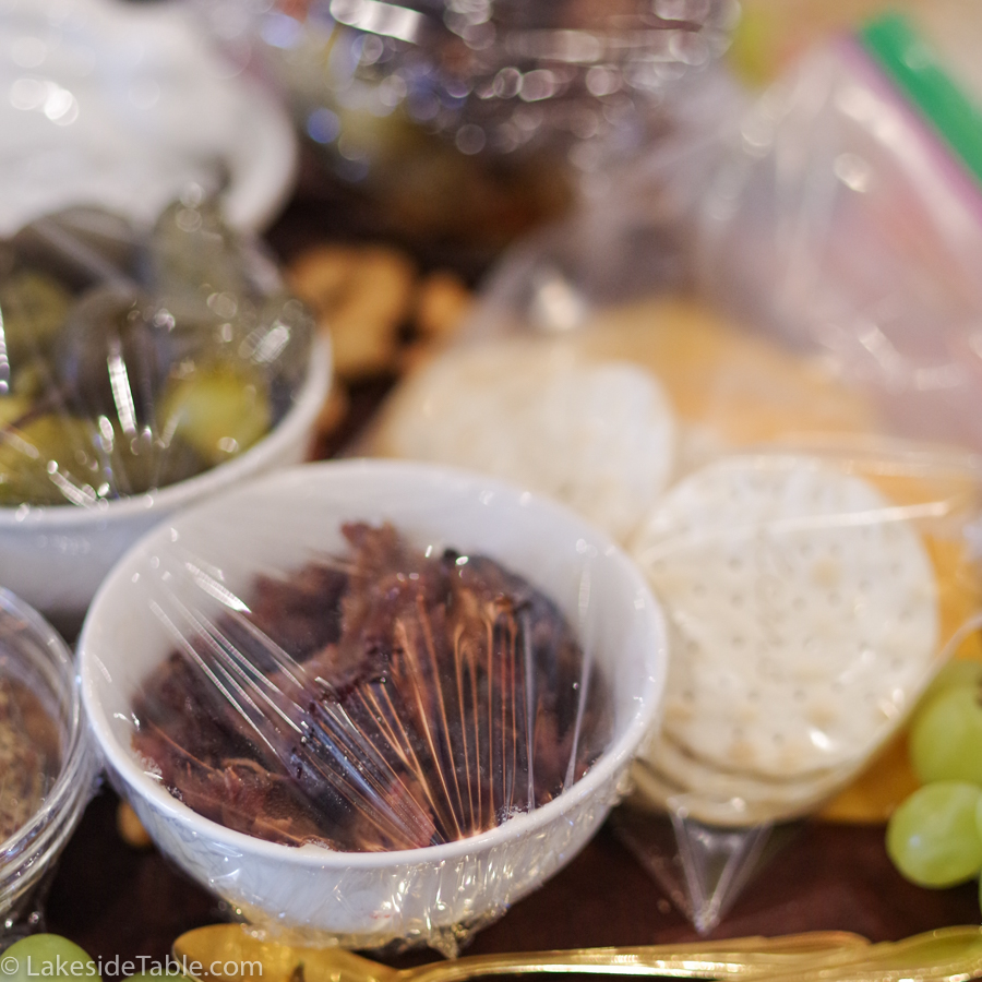 Small charcuterie dishes covered in plastic