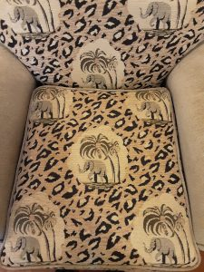 VINTAGE UPHOLSTERED CHAIR & OTTOMAN