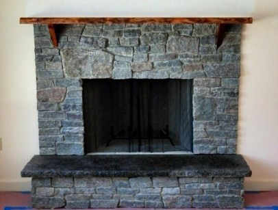Dark ledge stone with rustic mantel