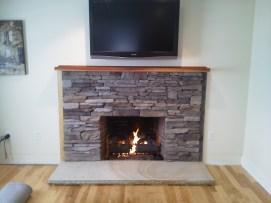 Custom ledge stone veneer with New Hampshire granite hearth - NH Chimney Sweep