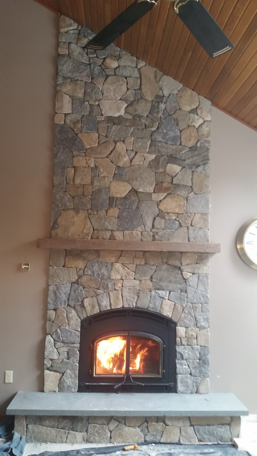 High efficiency wood burning fireplace with natural stone
