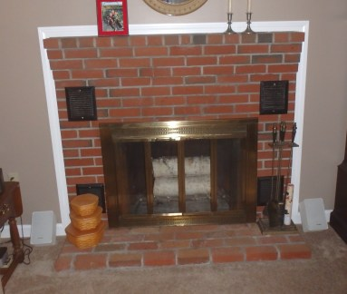 Before a Complete fireplace makeover inside and out! Work done includes , rebuilt firebox and smoke chamber, repaired flue with HeatShield, new brick hearth with granite extension, custom glass doors and mantel