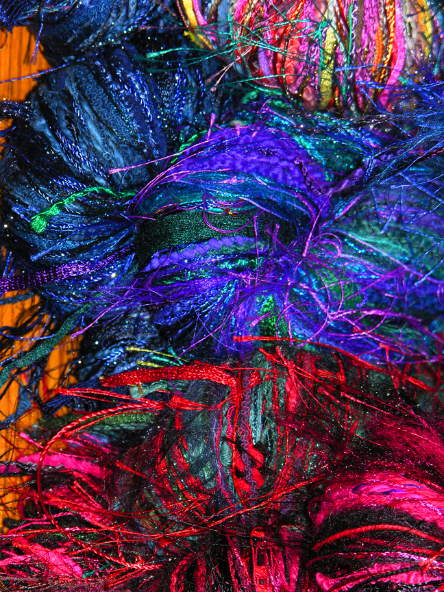 Photo of blue red magenta yarn