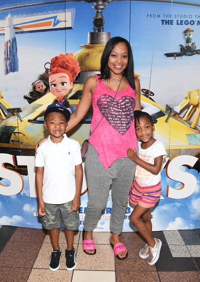"""ATLANTA, GA - SEPTEMBER 03: Mason Evan Smith, Monyetta Shaw, and Madeline Grace Smith attend the """"Storks"""" private screening hosted by The Ludacris Foundation & Unspoken Angels at Regal Cinemas Atlantic Station on September 3, 2016 in Atlanta, Georgia. (Photo by Paras Griffin/Getty Images for Warner Bros.) *** Local Caption *** Madeline Grace Smith;Monyetta Shaw;Mason Evan Smith"""