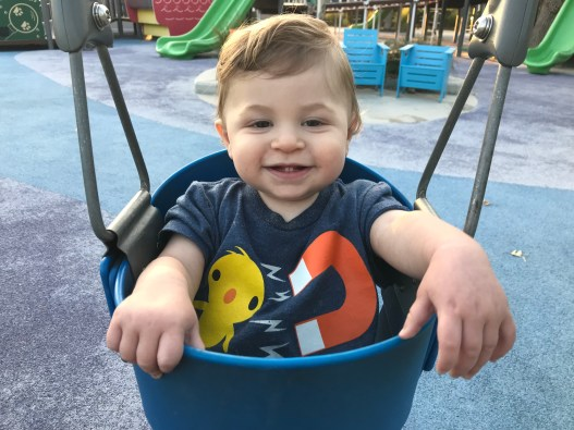 Baby in a swing at the park