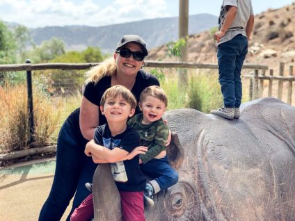 Me and my boys at the San Diego Zoo Safari Park playing at the park on a rhino