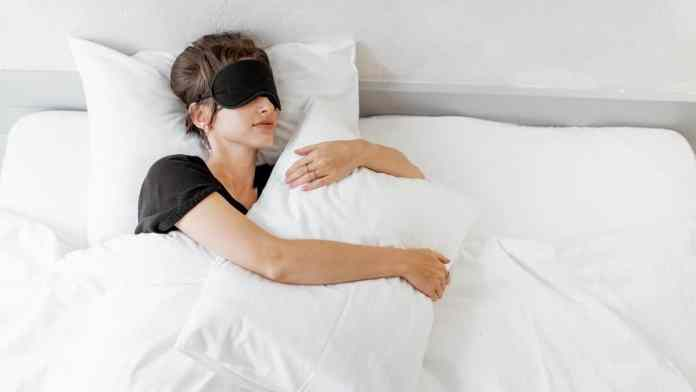 sleeping woman with eyemask