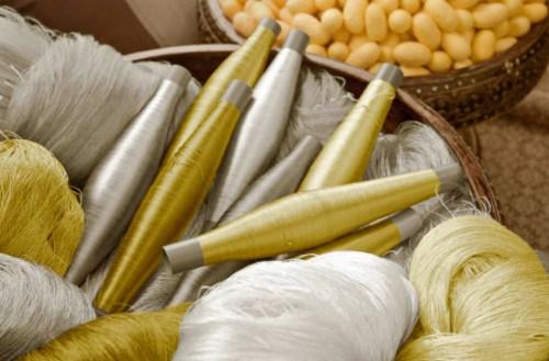 Golden and white silk yarn in a basket