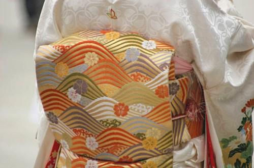 A Japanese silk kimono and silk obi belt