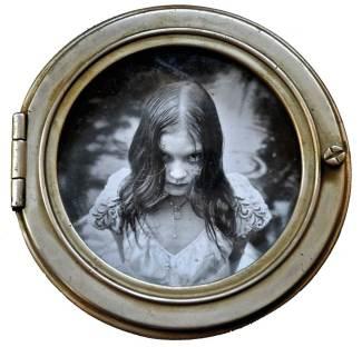 "Silver print photo, oil paint, metal, glass, resin 8.25"" diameter $1,200.00"