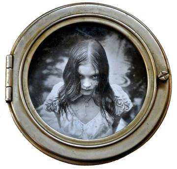 "Silver print photo, oil paint, metal, glass, resin 8.25"" diameter $1,200.00"