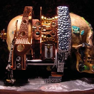 "Copper, aluminum, brass, bronze, titanium, silver, gold, mercury, the artist's blood, wood, glass, pearls, rubies, sapphires, turquioses, human skull, human jaw, and sand 24"" x 44"" x 90"" $250,000.00"