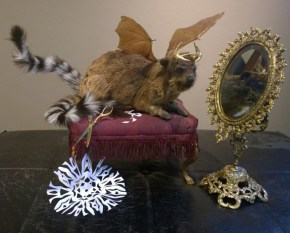 Hyrax hide, raccoon tails, epoxy/gilded antlers, taxidermy form, mirror, scissors, paper, footstool, bat wings, lacquer, and acrylic, 16 x 22 x 12 in. $4,800.00