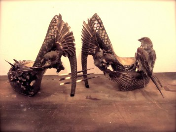 Naturally deceased English sparrows, Swarovski crystals, natural smoky quartz crystals, shed porcupine quills, epoxy, excelsior, twine, handmade high heel shoes (metallic printed cow leather, kidskin, epoxies, latex foam-all tooling, lasts, heel, platform, and components are handmade in U.S.A. and Europe) Variable based on installation, each shoe is 7 x 4 x 8 in. $3,500.00 for custom order upon request (pleast note that each pair is custom made for the client in their own shoe size.)