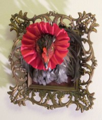 Hen framed in an ornate vintage frame, and red ribbon, 10 x 9 x 2 in. $250.00 Sold