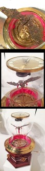 Small Footed Bat, genuine garnet & golden topaz gemstones set in 14k gold, antique gold gilded roses, wooden cremation urn, antique clock parts, music box. Movement: crank shaft. A hand crank makes the bat move up and down to flap his wings. 25 x 13 in. in diameter, $1,800.00