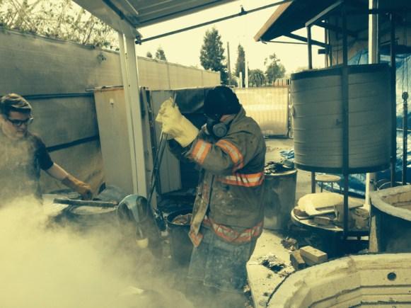 Don Fritz putting Rocket Car in the kiln at his studio