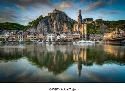 DINANT, BELGIUM – JUNE 15, 2014: The Meuse River passing through the town of Dinant, located in the Walloon, Belgium.