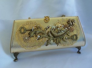 gold purse with feet