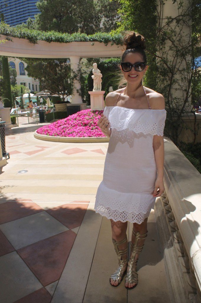 White eyelet beach cover-up with metallic gladiator sandals