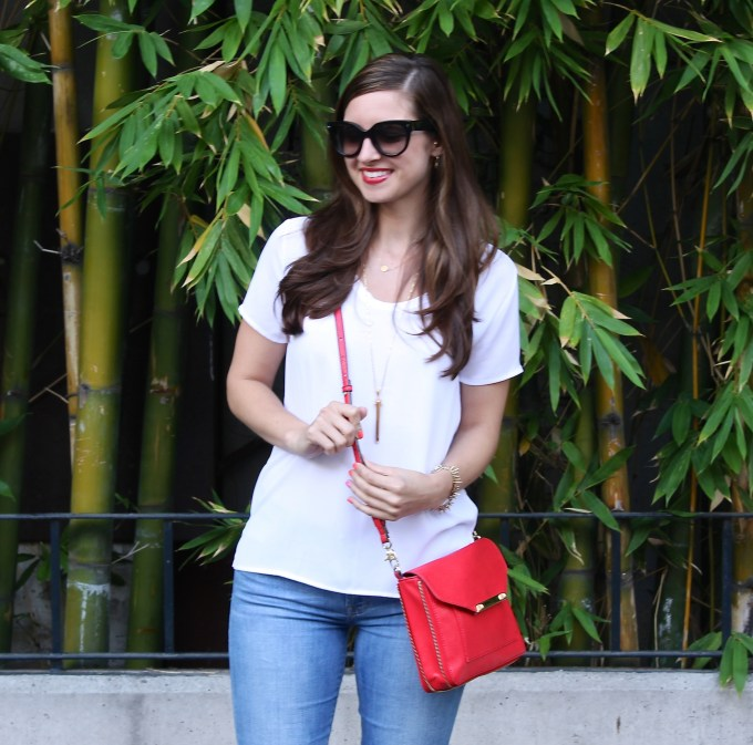 White Blouse with Red Purse and Shoes
