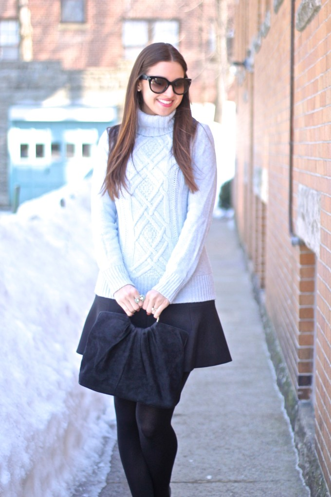 Heathered Blue Cambridge Turtleneck Sweater and Fluted Black Skirt with Loafer Tassel Heels