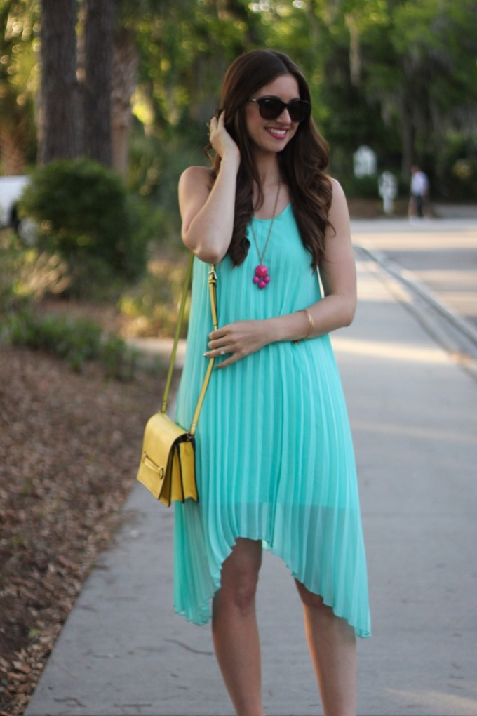 Aqua pleated chiffon high-low dress with yellow and pink accessories