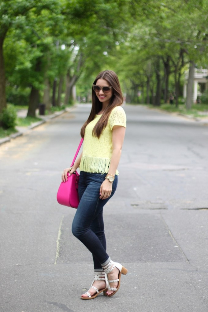 H&M Yellow Lace top with Fringe, high-waisted Rag n Bone Jeans and White Gladiator Sandals with Neon Pink Kate Spade Bag