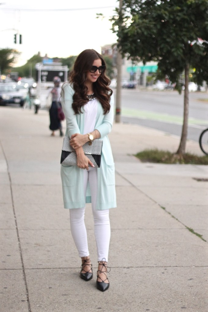 All white with oversized long mint cardigan sweater and black pointy lace-up flats