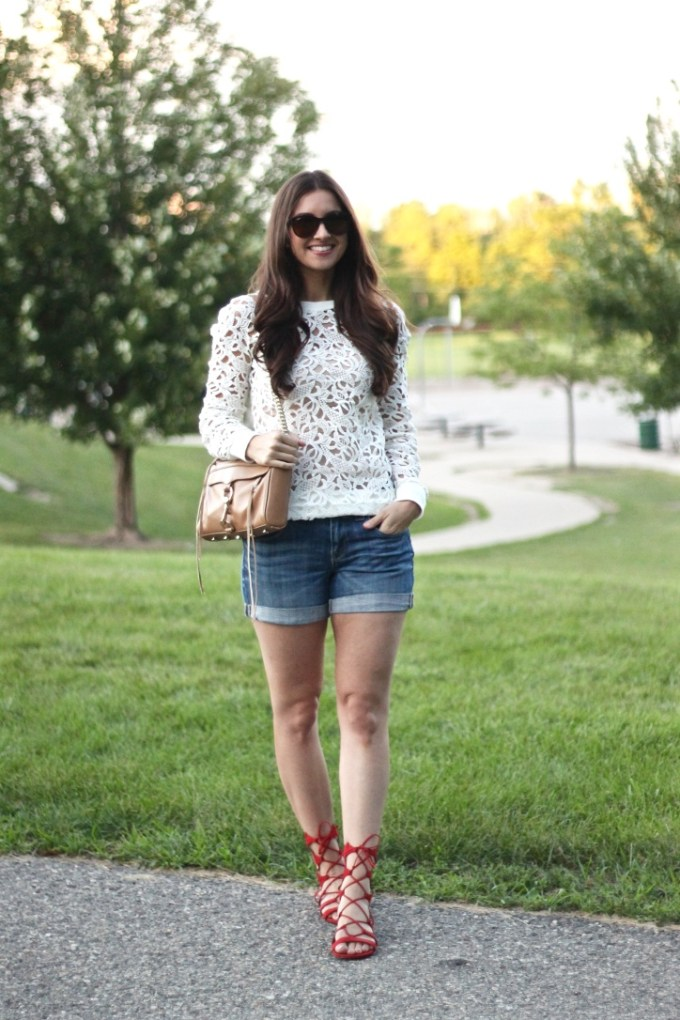 White Urban Outfitters Cutout Sweater with J.Crew Denim Roll-up Shorts and Schutz Red Lace-up Sandals