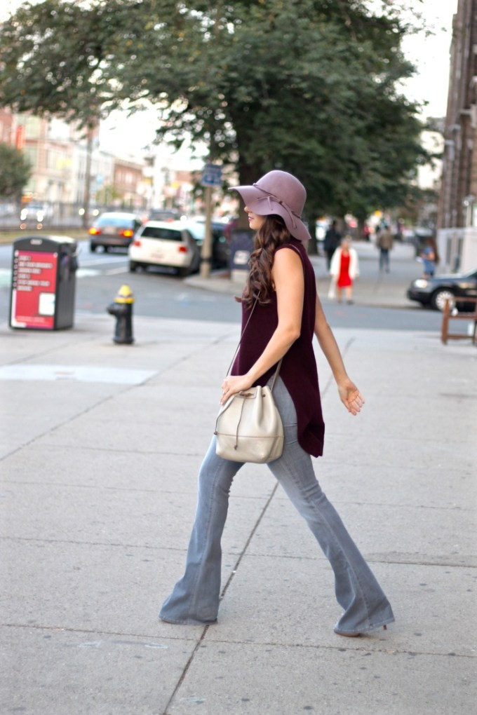 Primark Burgundy Sleeveless Roll Neck Sweater; JBrand Martini Flare Jeans; BCBG Lavender Floppy Wool Hat; Grey Leather Bucket Bag