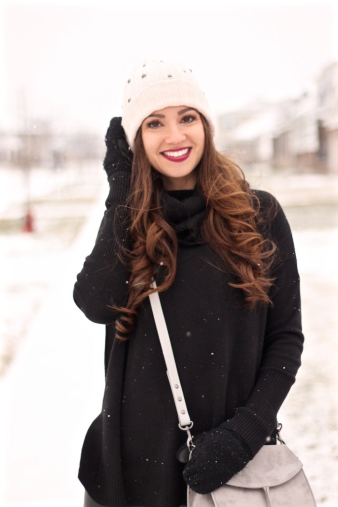 All black winter outfit with studded beanie, grey tassel bag, cheap black leather leggings
