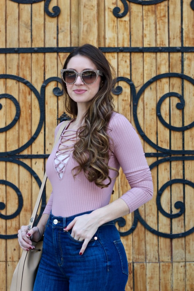 Blush pink lace-up bodysuit, Monki High-waisted jeans, Prada Cat Eye nude sunglasses
