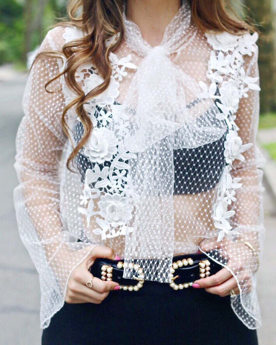Peekaboo Shop this sassy top and pearl belt here gthellip